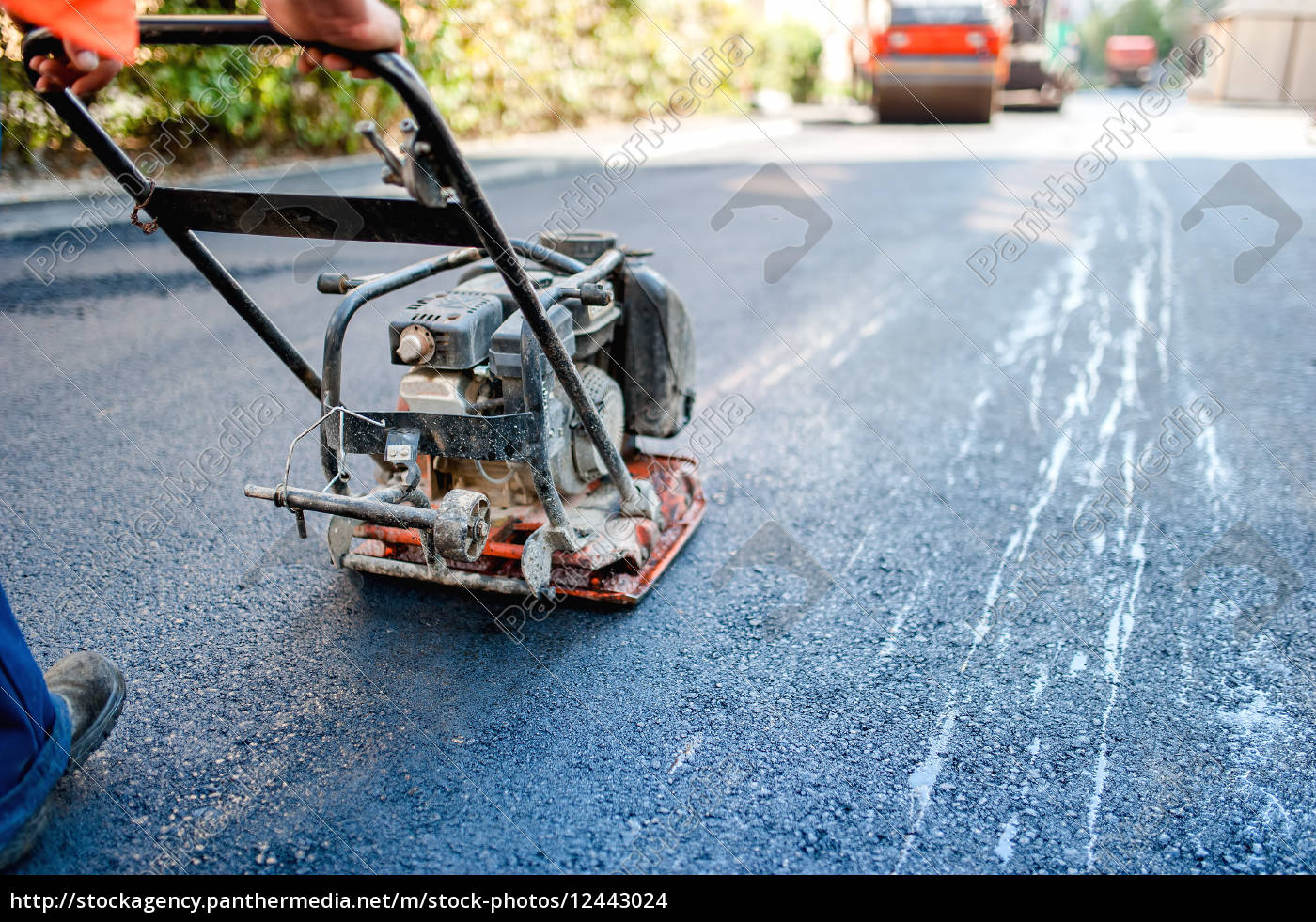 Royalty free photo 12443024 - road construction with worker paving the  fresh bitumen or