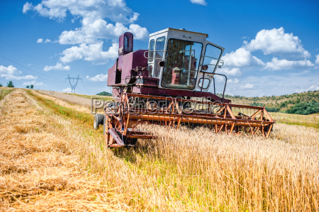 old combine corn and wheat harvester