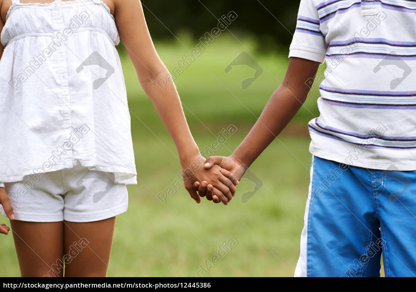 Children Love Black Boy White Girl Holding Hands Royalty Free