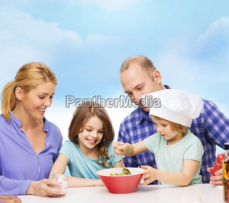 happy family with two kids eating