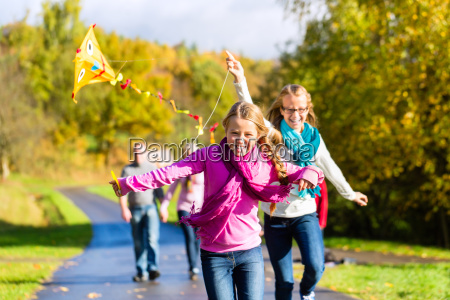 family in autumn walk in the