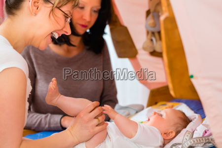 midwife examines infant