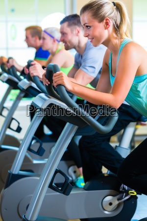 people spinning at the gym on