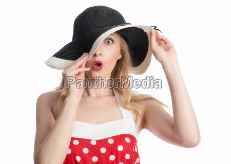 astonished woman in hat