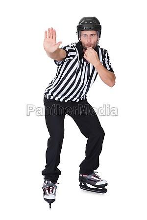 portrait of hockey judge whistling