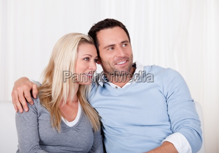 affectionate couple relaxing on a sofa