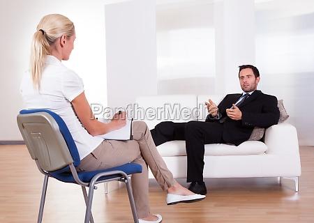 man talking to his psychiatrist