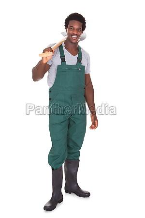 gardener holding shovel