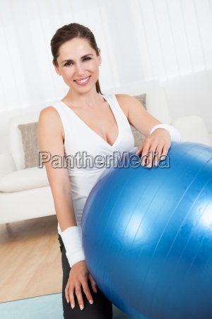 happy woman with a pilates ball