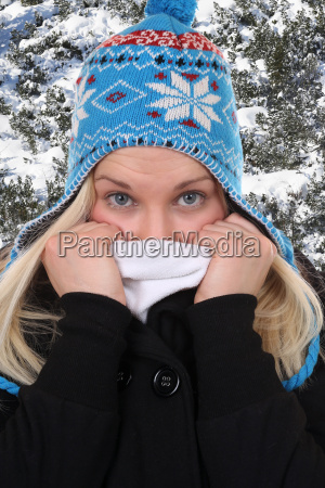 young woman in winter while freezing