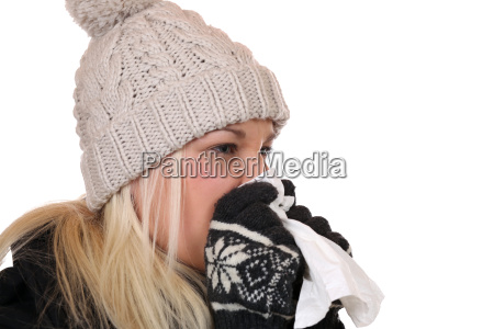 young woman with handkerchief is sick