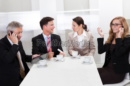 business executives enjoying coffee