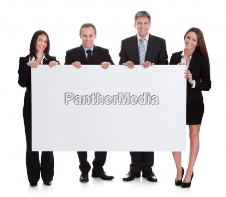 business people holding placard