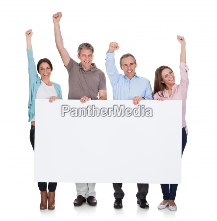 group of happy people holding placard