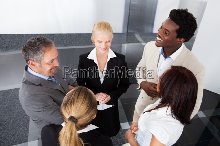 mature businessman with his colleagues