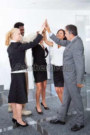 business people celebrating with a high