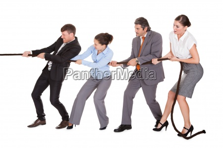 businesspeople pulling rope
