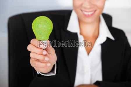 businesswoman with green bulb