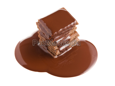 pouring chocolate on chocolate bar