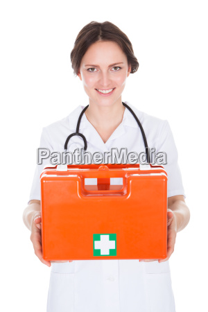 female doctor holding first aid box