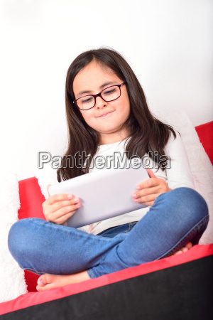 schoolgirl learning with a tablet pc