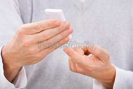 man examining blood sugar level
