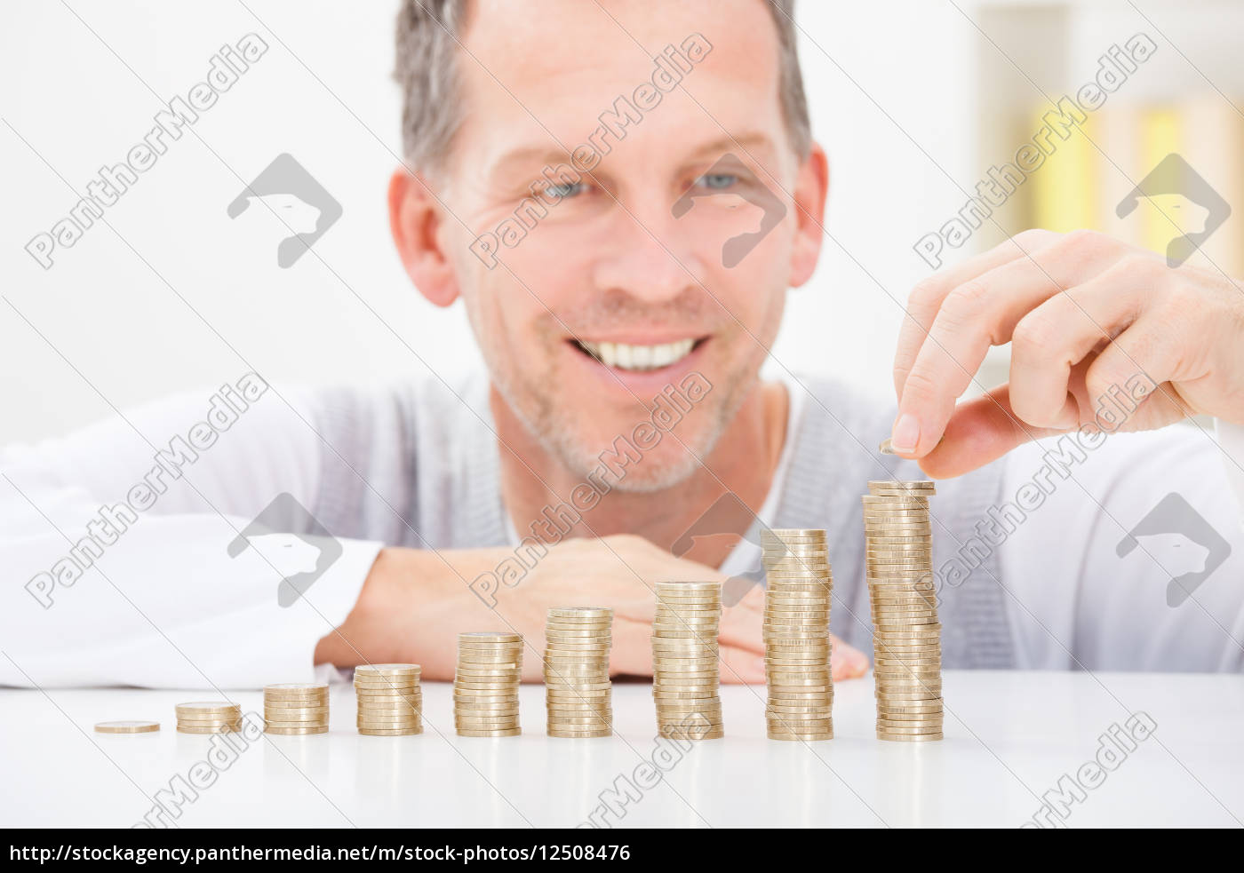 mature, man, stacking, coins - 12508476