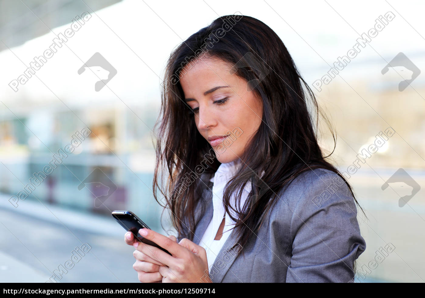businesswoman, sending, message, with, smartphone - 12509714