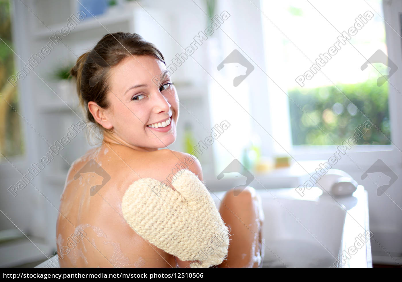 gorgeous, woman, scrubbing, her, back, in - 12510506