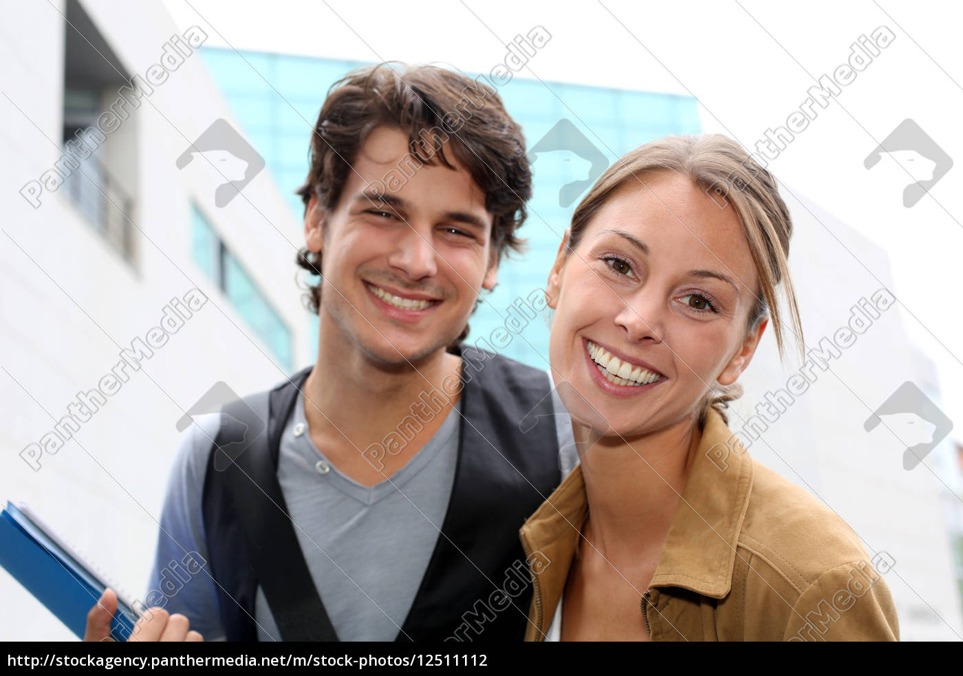 cheerful, couple, of, students, standing, on - 12511112