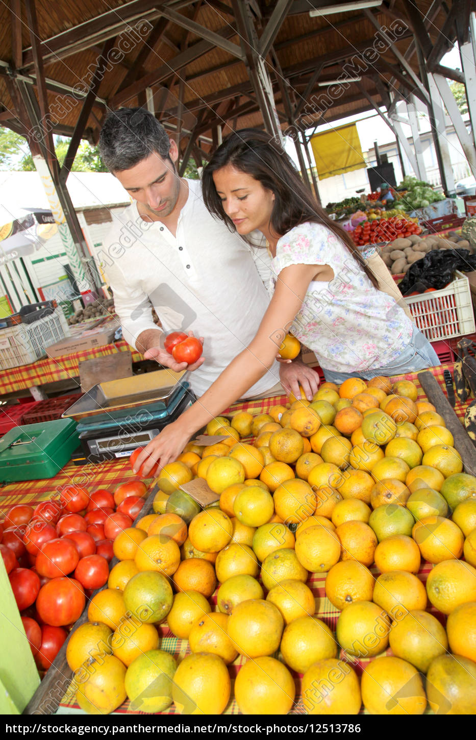 cheerful, couple, choosing, fruits, in, outdoor - 12513786