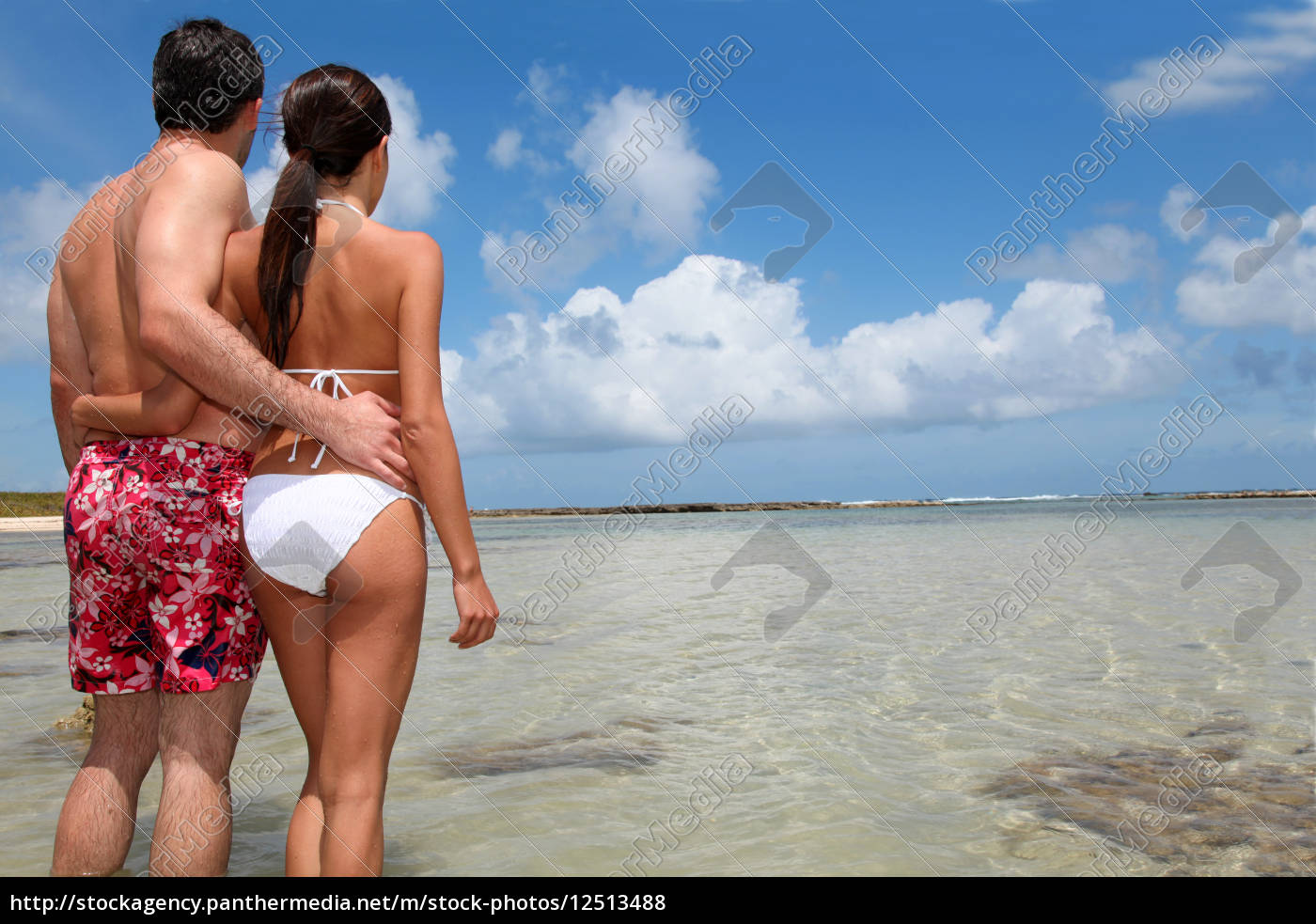 couple, in, swimsuit, standing, by, a - 12513488