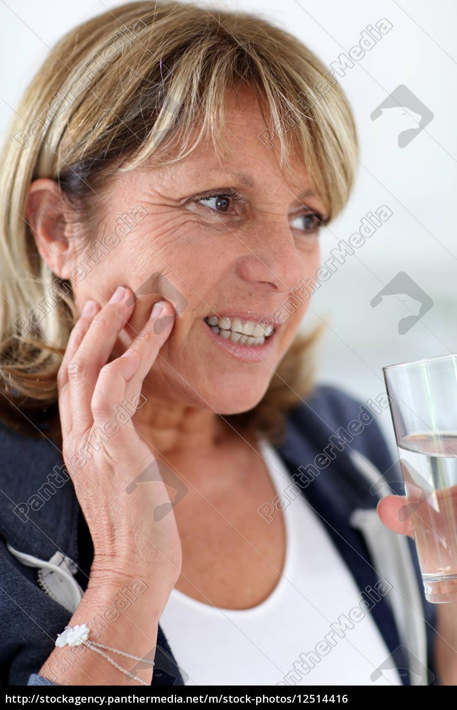 closeup, of, senior, woman, having, toothache - 12514416