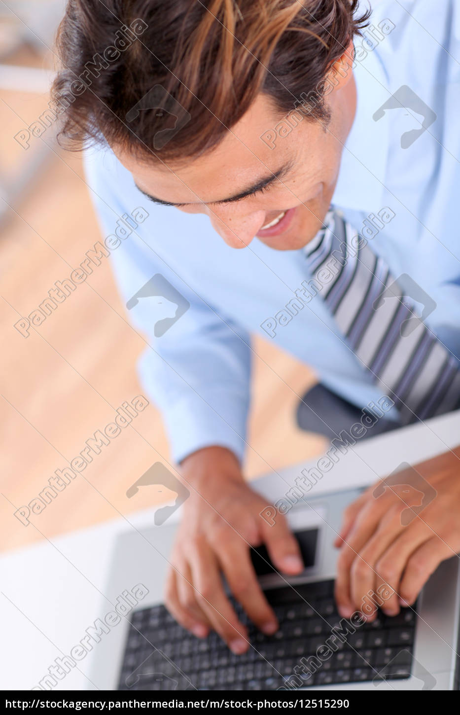 closeup, on, businessman, typing, on, keyboard - 12515290