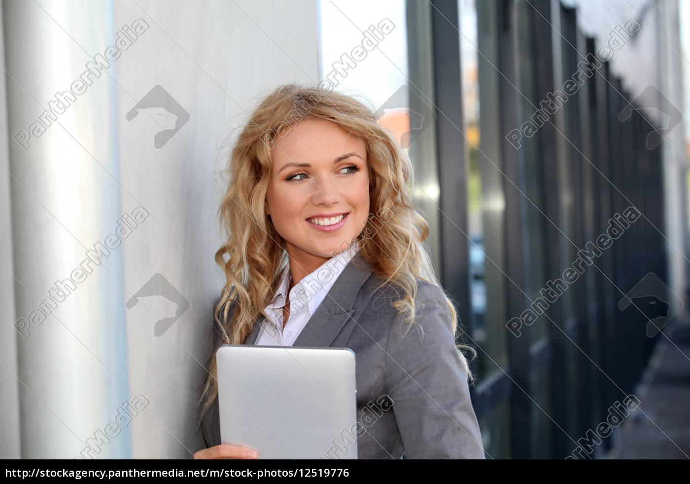 businesswoman, standing, outside, with, electronic, tablet - 12519776
