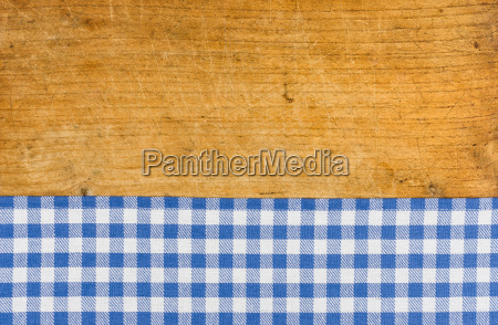 rustic wooden background with a blue