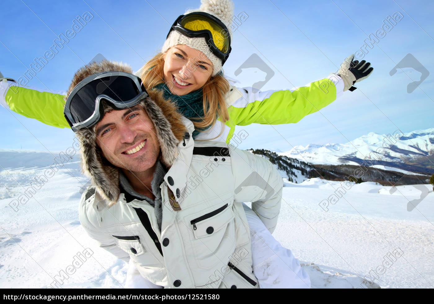 cheerful, snowboarder, holding, girlfriend, on, his - 12521580