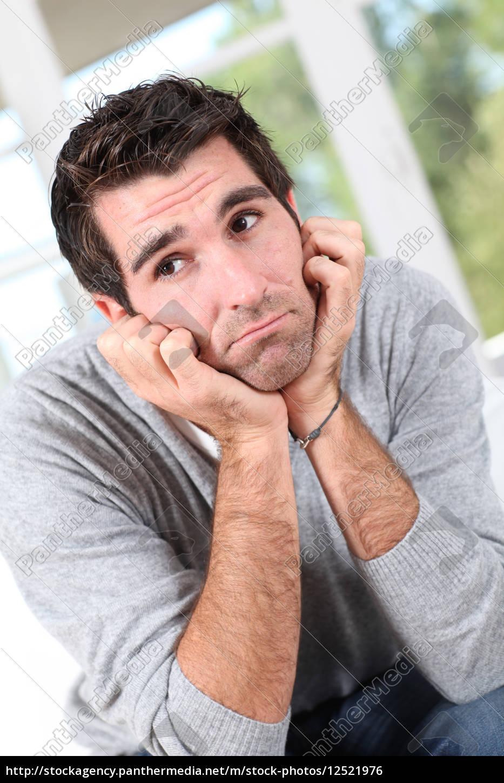 portrait, of, man, with, sad, look - 12521976