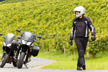 motorcyclist with a helmet goes on