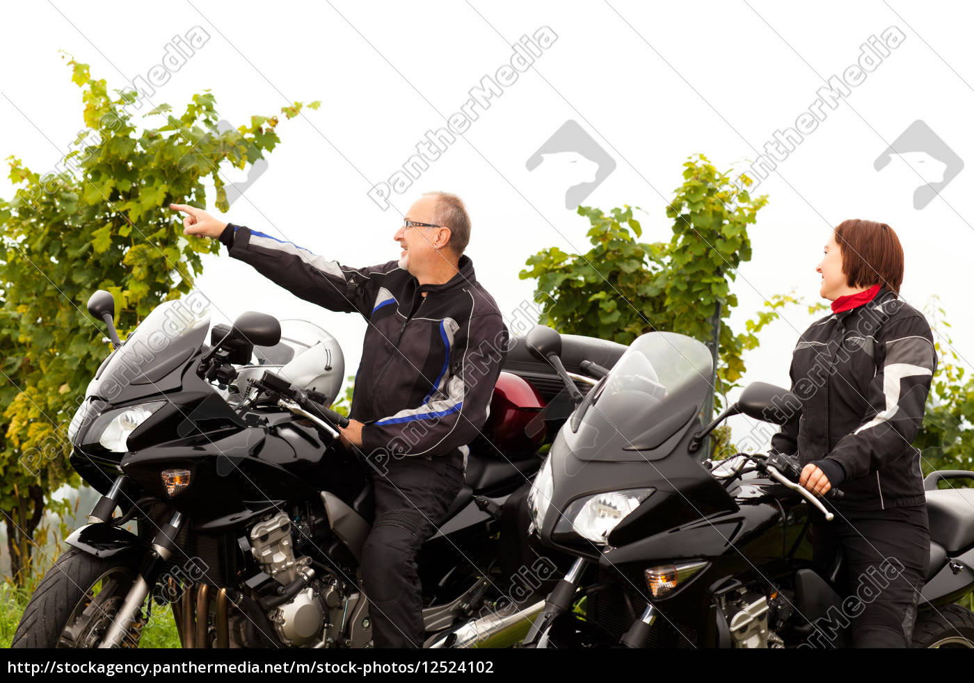 two, motorcyclists, talk, about, the, landscape - 12524102