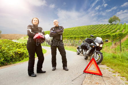 two, motorcyclists, with, panne, are, waiting - 12524118