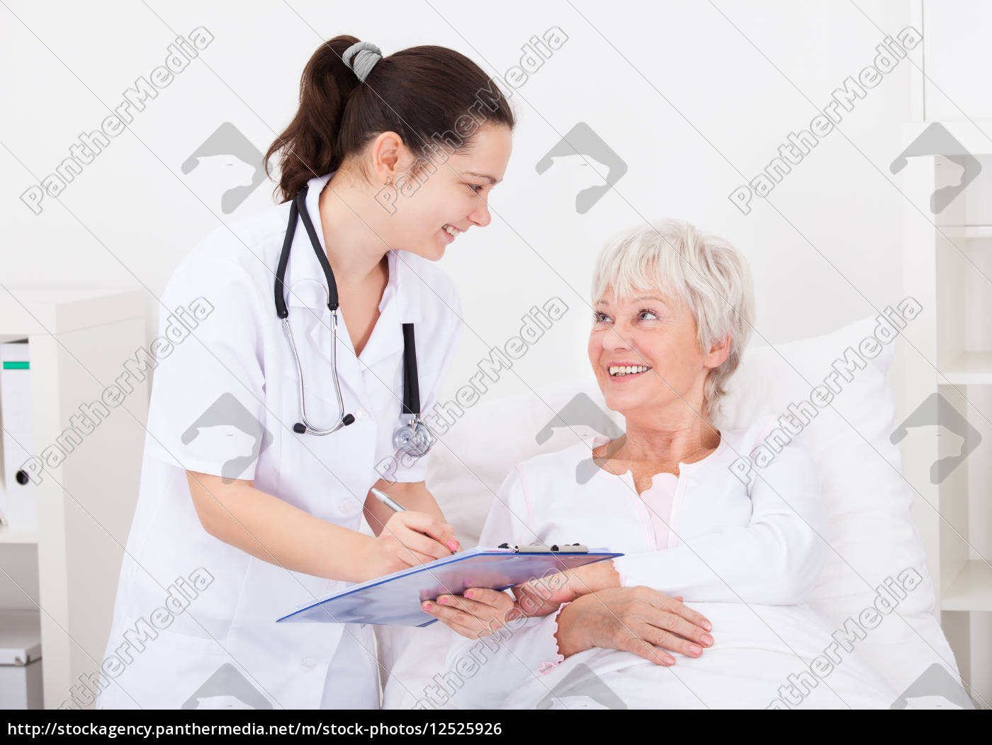 doctor, giving, prescriptions, to, patient - 12525926