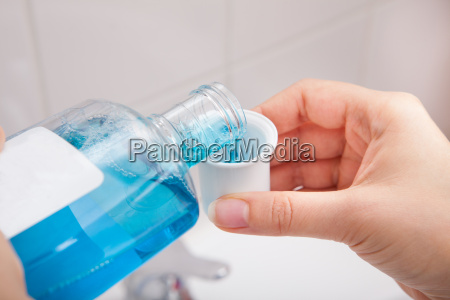 person, pouring, liquid, in, container - 12525746
