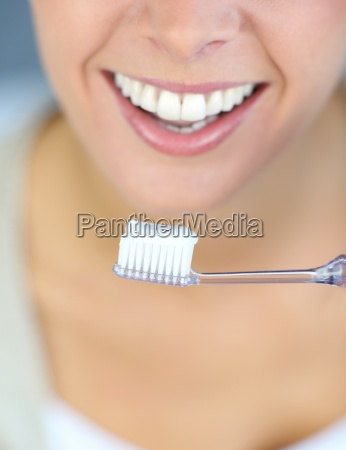 closeup, on, woman's, toothy, smile, brushing - 12528732