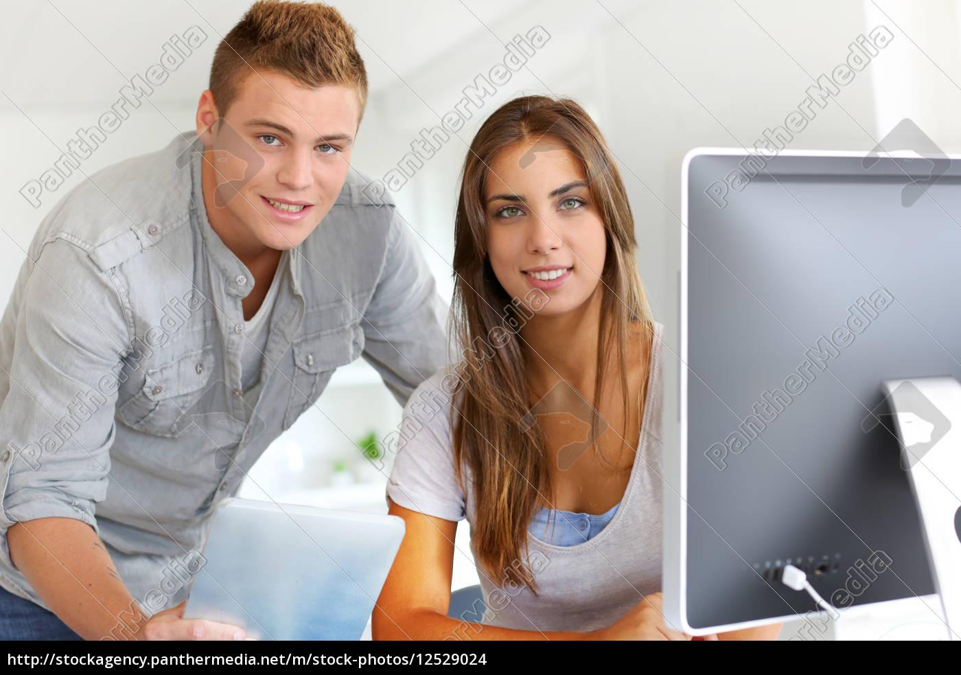 trainees, in, office, working, on, desktop - 12529024