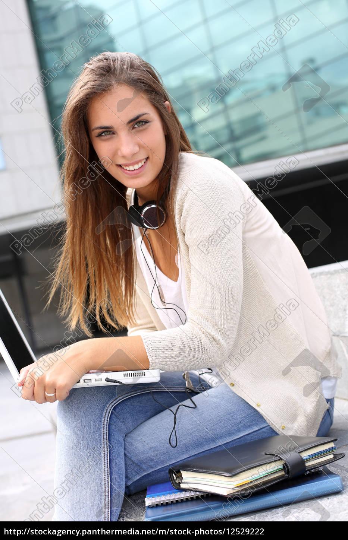 young, girl, at, university, using, laptop - 12529222