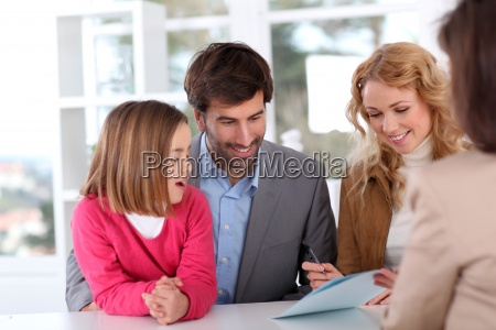 family signing real estate contract