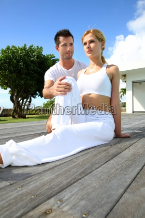 woman, with, personal, trainer, exercising, outside - 12531238