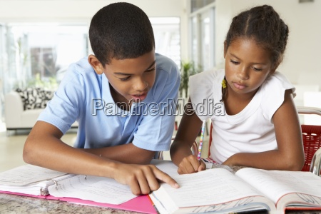 two children doing homework together in