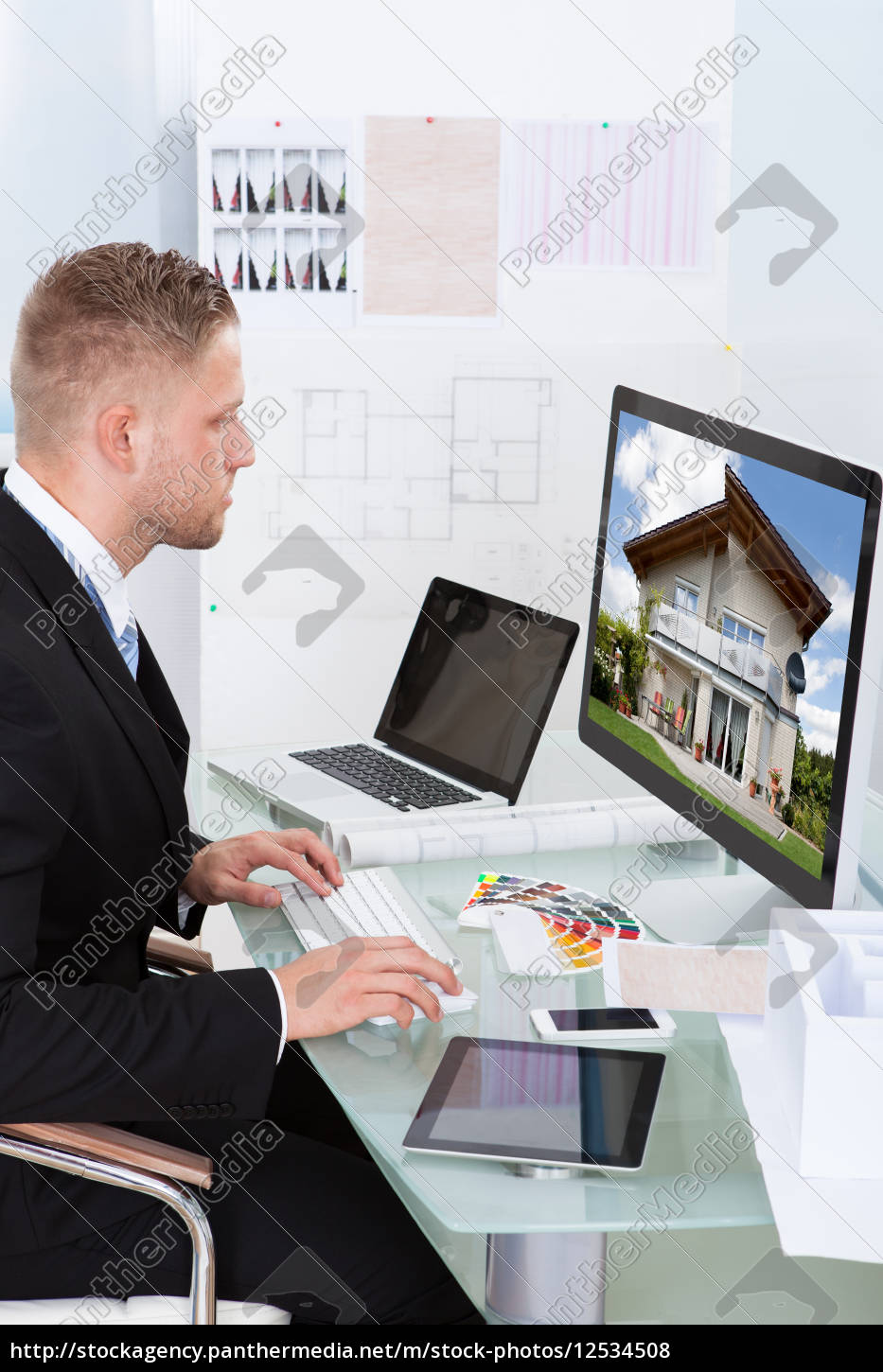businessman, checking, a, property, portfolio, online - 12534508